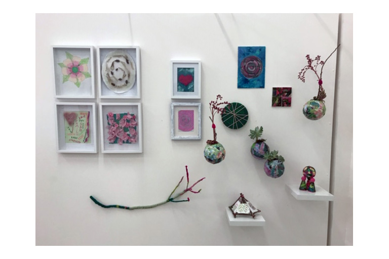 A series of small artworks hanging on a wall