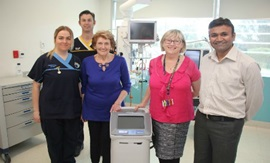 Hospital staff standing beside ICU cooling machine